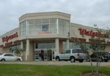Walgreens  raises quarterly dividend 27.3%