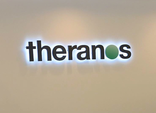 Theranos logo on wall