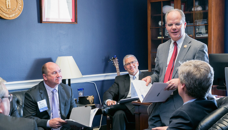Rep. Brett Guthrie (R., Ky) meeting with the NACDS Board of Directors, with Hy-Vee's Randy Edeker and Thrifty White's Bob Narveson seated at left.