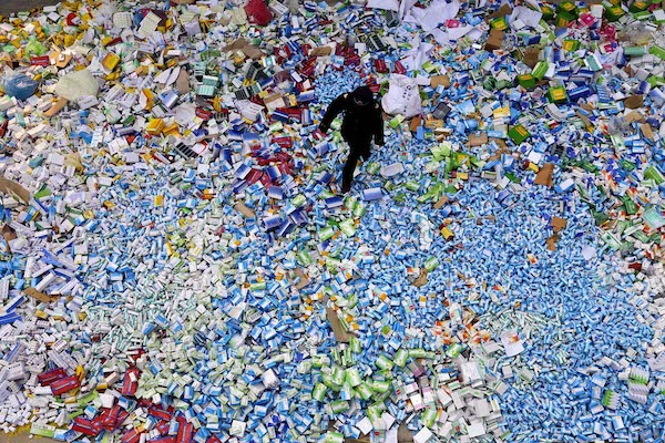 This picture taken on March 14 shows a Chinese policeman walking across a pile of fake medicines seized in Beijing in recent months, which were later destroyed. The rapid growth of Internet commerce has led to an explosion of counterfeit drugs sold around the world, with China the biggest source of fake medicines, pharmaceutical experts said as the illicit trade is now believed to be worth around 75 billion USD globally, with criminal gangs increasingly using the web to move their products across borders. CHINA OUT AFP PHOTOSTR/AFP/Getty Images ORG XMIT: