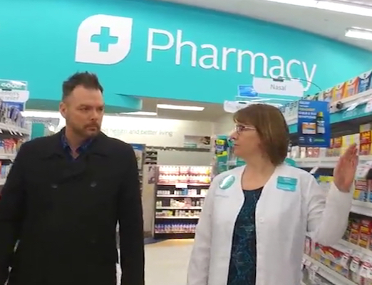 Rexall pharmacist with customer