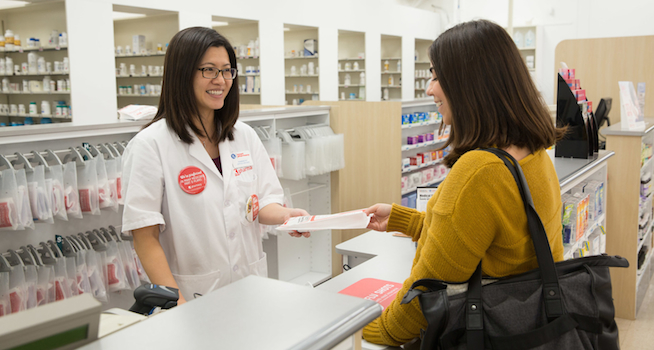 Kmart pharmacist with patient_Kmart Pharmacy